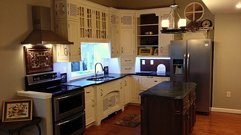 Kitchen cabinets with undercabinet lighting in Middletown, CT